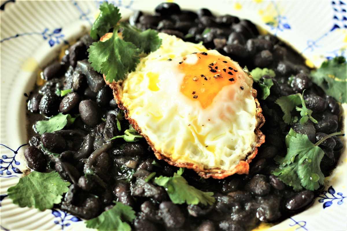 Crispy Fried Egg and Black Beans Image